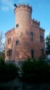 Пластиковые окна-арки в доме-крепости