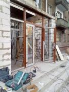 Остекление входа в магазин пластиковыми окнами wds