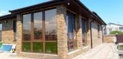 Остекление окнами Rehau террасы в частном доме